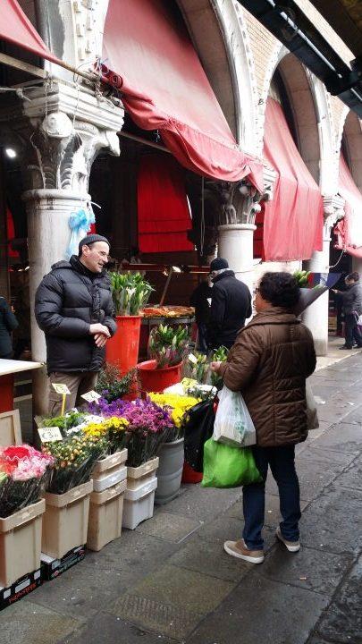 Shopping and chatting at the Rialto market