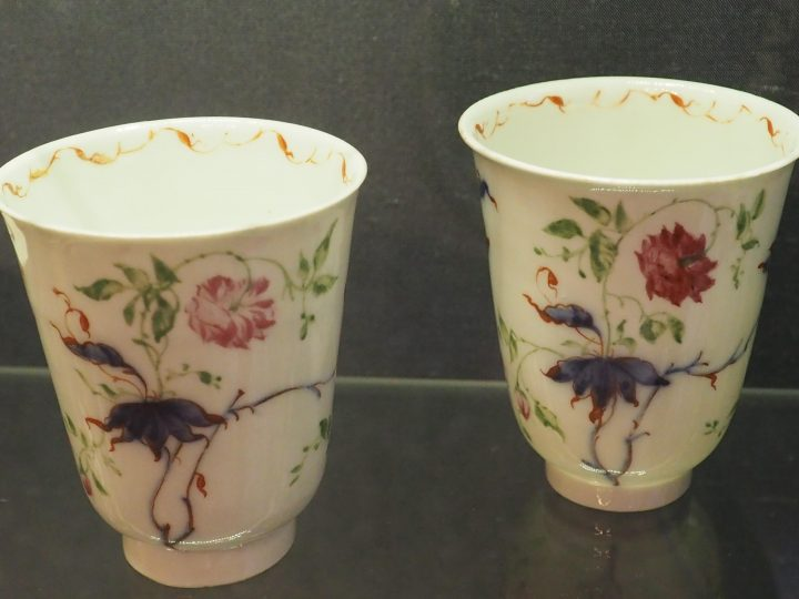 2 bell-shaped cups with very thin edges, with peonies and branches with leaves