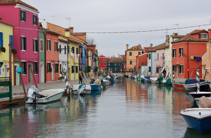 Burano, its colourful houses and boats on a calm winter day