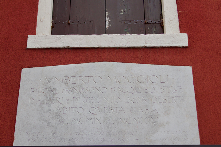 "the inscription reminding us this was the home to Umberto Moggioli on the island of Burano : ""Franciscan painter of waters and stars, of trees and skies in the desert lagoon"""