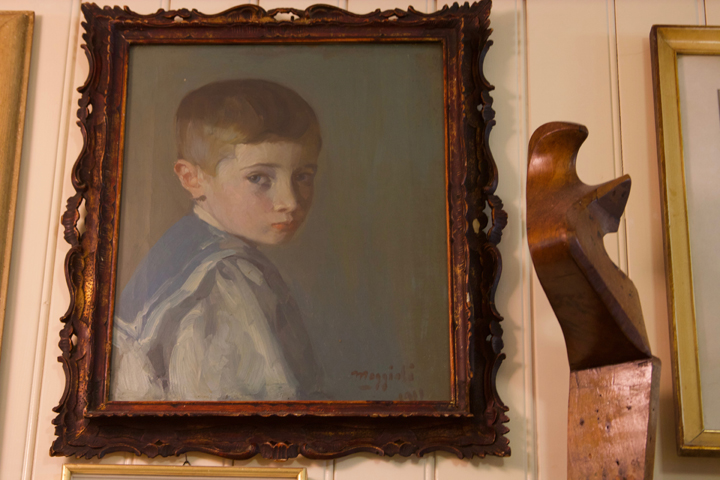 Portrait of a young boy by Umberto Moggioli in in Da Romano restaurant in Burano