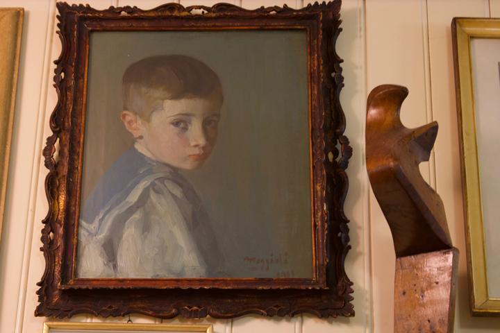 Portrait of a young boy by Umberto Moggioli in in Da Romano restaurant in Burano