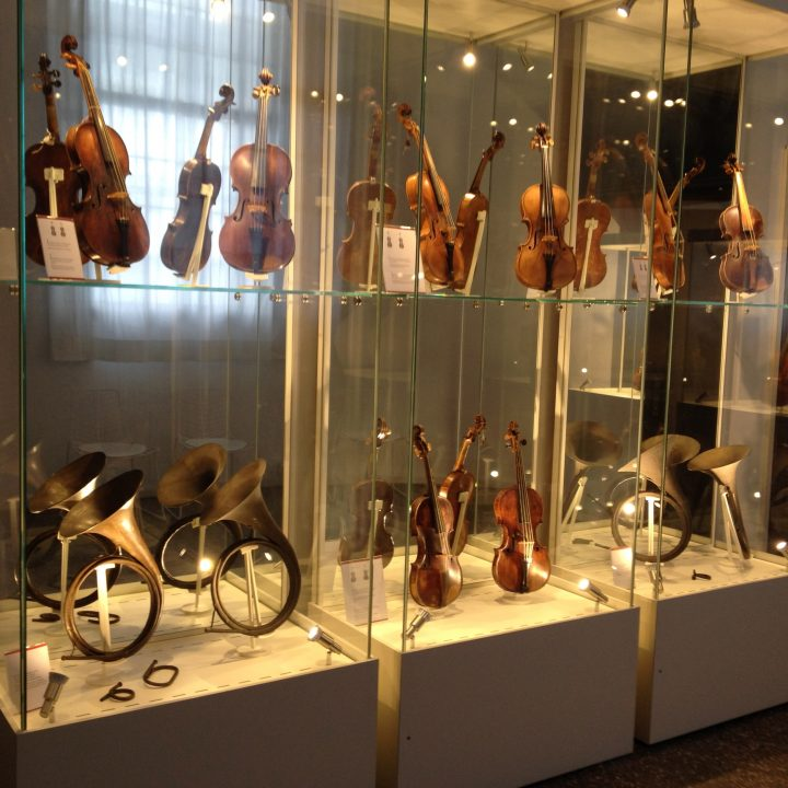 Violins and brass horns, also reflected by the back mirror