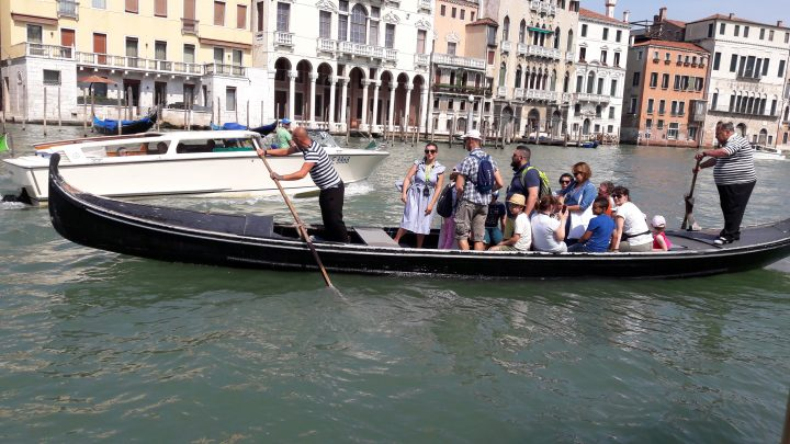 Getting across the Grand Canal by standing gondola (Traghetto)