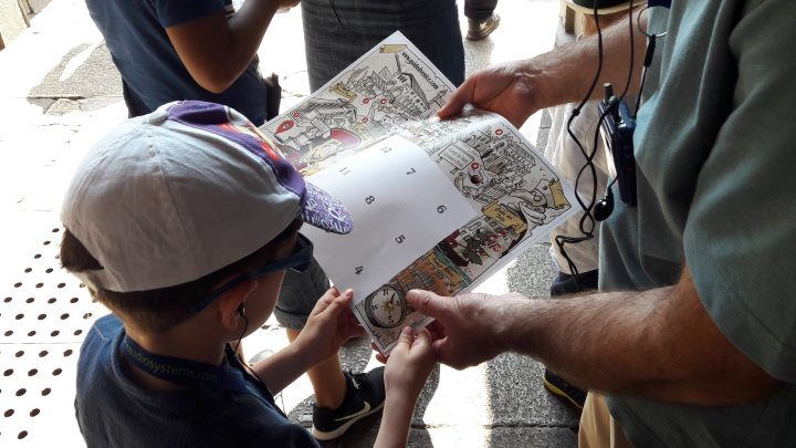 A child using the map for the tour