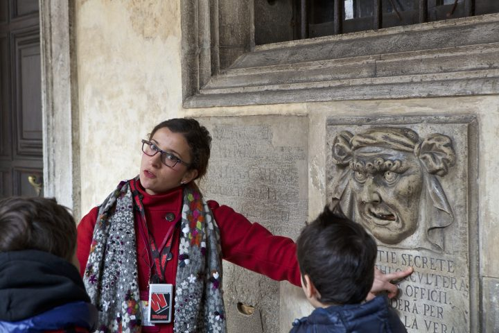 Some kids learning about the palace in a scavenger hunt