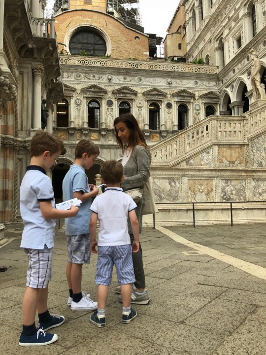 in front of the Giants' Staircase in the courtyard of the Doge's palace