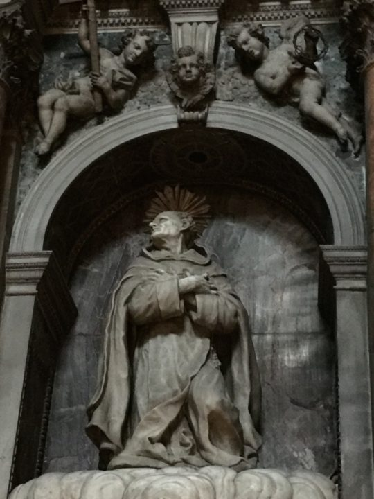 Photo 10 statue of St. John of the Cross, made of Carrara white marble which has yet to be cleaned from centuries of dust. The back wall of the niche is made of jasper, a very precious marble. Detail of the chapel dedicated to him