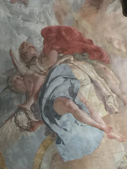 Photo 13 angels by Tiepolo with the crown of thorns and red robe of Jesus, detail of the fresco in the chapel of the Crucifix