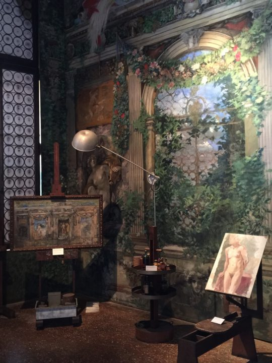 photo 4: glimpse of Mariano's studio with paintings on easels and Fortuny lamp (Palazzo Fortuny House-Museum)