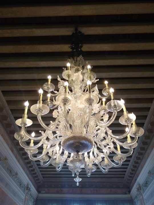 "The Murano glass chandelier in the ""portego"""