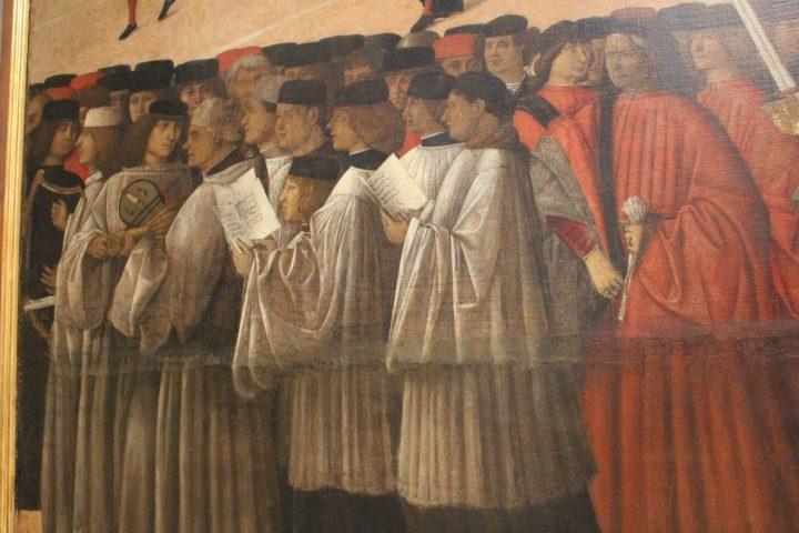 photo 13) Gentile Bellini : Procession sur la Place Saint-Marc 1496, détail ; les trois frères sont habillés strictement en blanc à l'extrémité gauche du tableau ; le rebec, autrefois dérivé d'un seul morceau de bois, est un instrument qui n'est plus utilisé sauf pour les exécutions philologiques