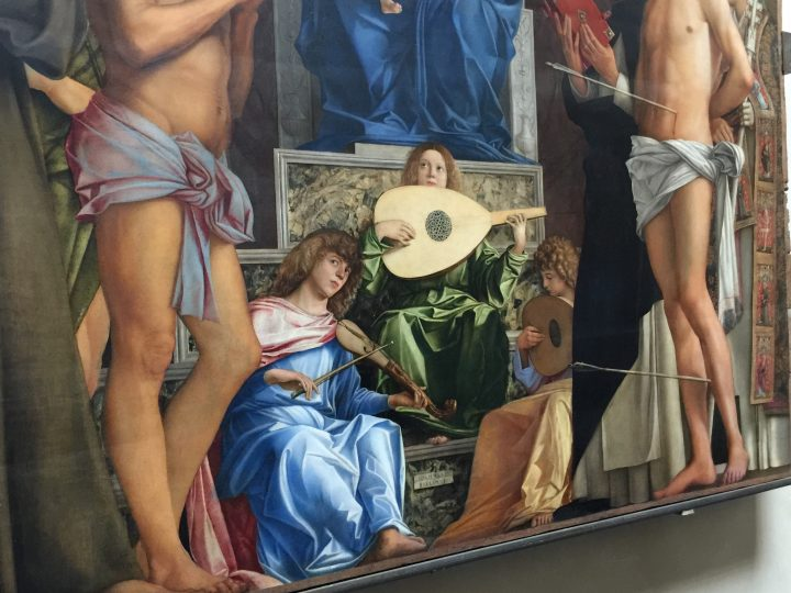 photo 17) an additional detail of the photo highlights the rebec and central lute, while the side lute is partially hidden by St. Dominic's robe