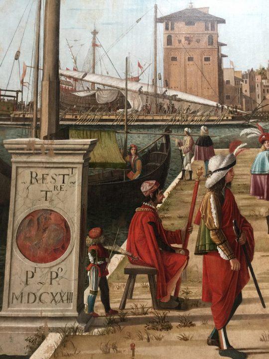 photo 20) Carpaccio : Cycle de Sainte Ursule, détail. Dans le Retour des ambassadeurs, près du porte drapeau, le joueur de rebec ;
