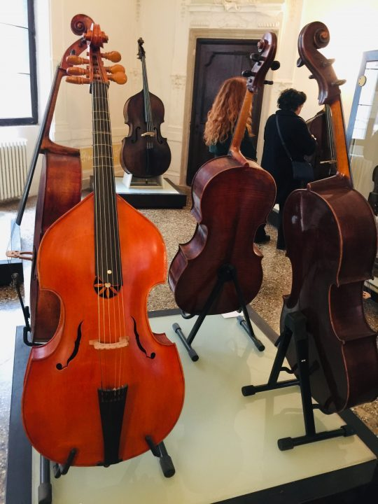 photo 14) our viola da gamba has a lovely light-coloured varnish; this kind of instrument has holes on the sound box different to those found on the rest of the family, cellos included, and is more pear-shaped. Of course it rests on a base and is played by being placed between the legs rather than lifted