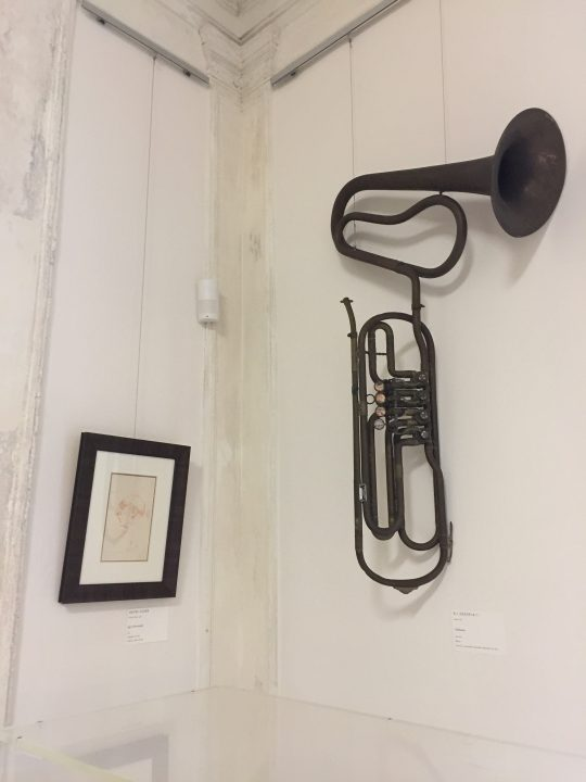 photo 24) the cimbasso on display was made in 1906-20 in Milan by Cazzani & C.; a lovely profile of Stravinsky can be seen on the left