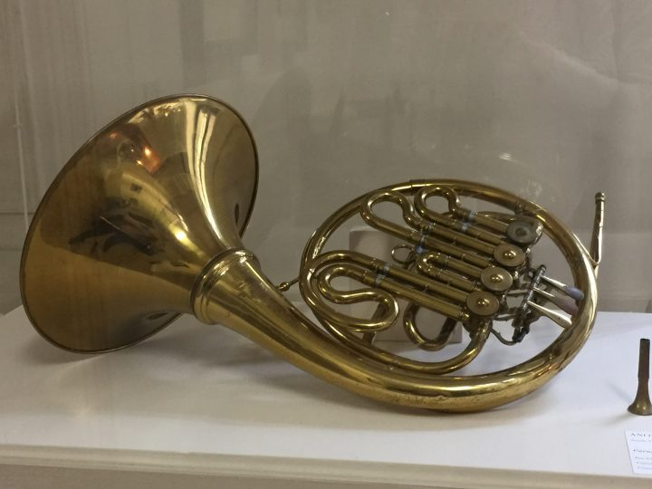 photo 30) the brass horn, also known as the French horn to distinguish it from the cor anglais (also known as the English horn) is a woodwind instrument as can be seen in photo 32. Originally made of tusks or animal horns