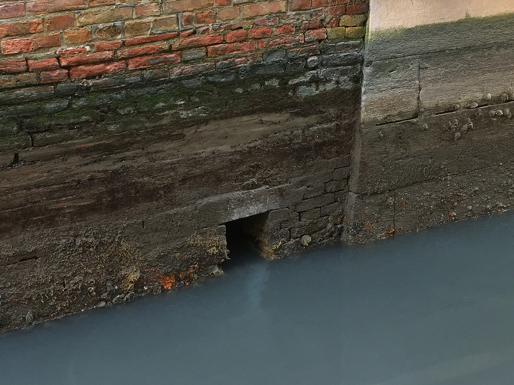"A typical ""gatolo"" allowing sewage to reach the canal in Venice"