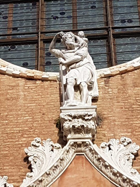 The statue of Saint Christopher at the cuspid of the portal of the church, realized in about 1460-1483 by Bartolomeo Bon