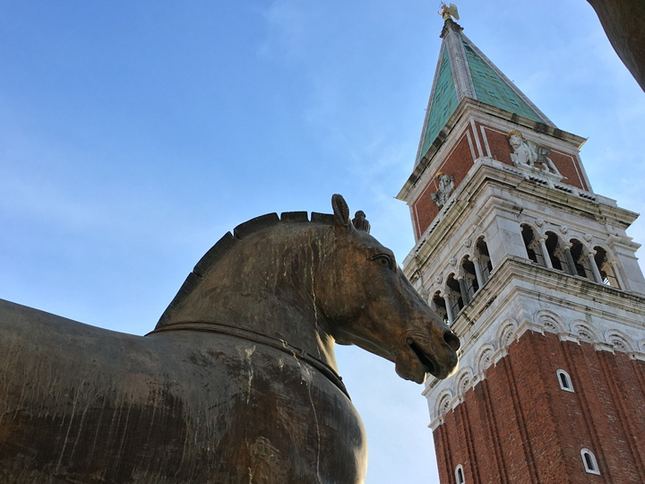 Contrasting with the Bell Tower, one of the modern horses in bronze standing on the terrace of St Mark's Basilica, Venice