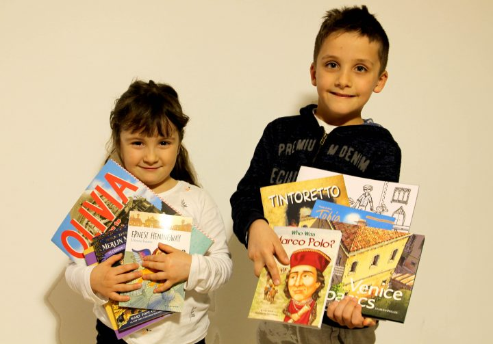 My kids with some of their favorite books on Venice