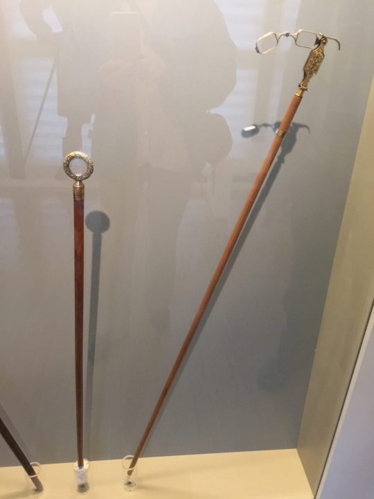 Figure 9 stick with incorporated handheld spectacles and another monocle-stick (=with incorporated lense). Eyewear Museum, Pieve di Cadore, both from the Bodart Collection