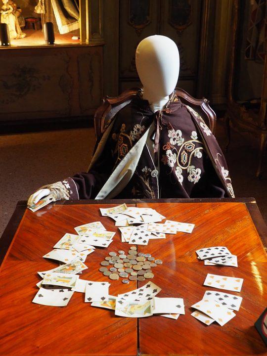 Gambler and game board, scene inspired by Carlo Goldoni's comedy The Gambler, Carlo Goldoni's Home, Venice